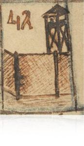 Een wachttoren en de matten van bamboe in het Jappenkamp